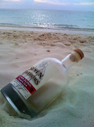 Cayman Rum Bottle on Beach